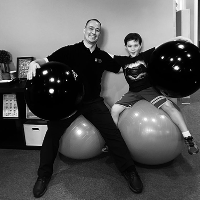Chiropractor Orange City FL Doctor Terry Watts and Child Exercise Balls